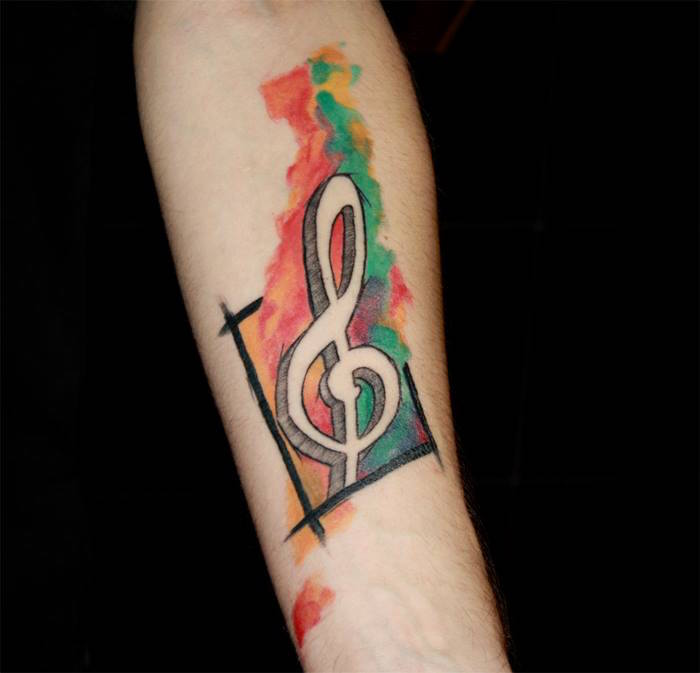 dessin clé de sol en couleur pour tatouage musique aquarelle