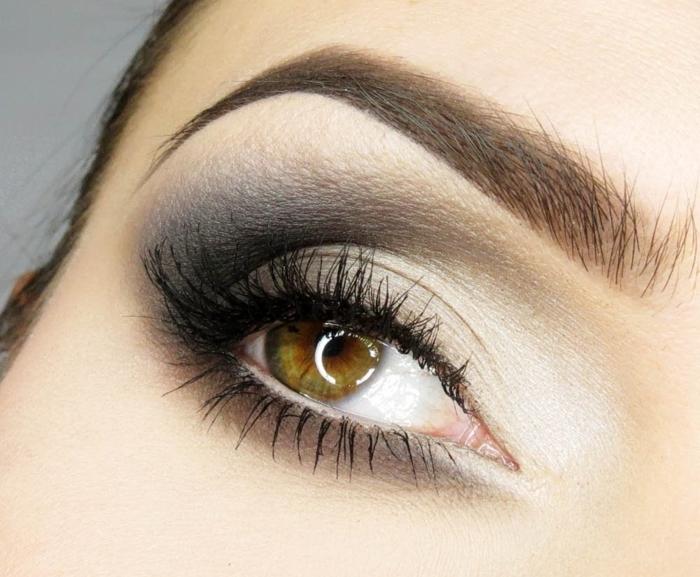 smoky eyes noir, mascara noir, fond de teint pêche, cheveux brunes, fard à paupières blanche