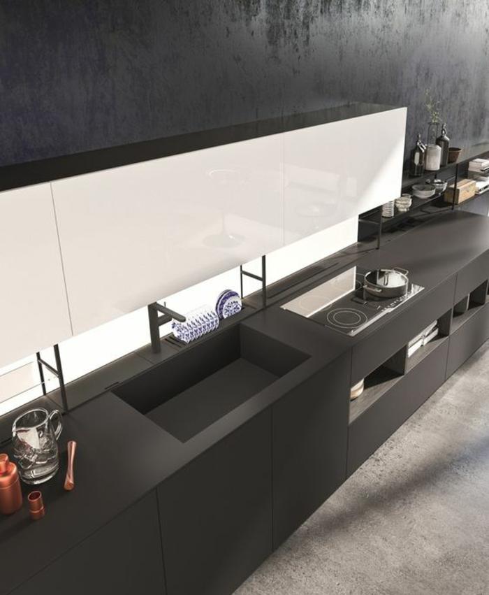 cuisine noire aux formes cubiques mur en blanc espaces de rangement