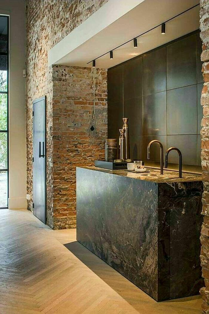 cuisine noire ilot carré en granit avec briques a l etat brut style industriel
