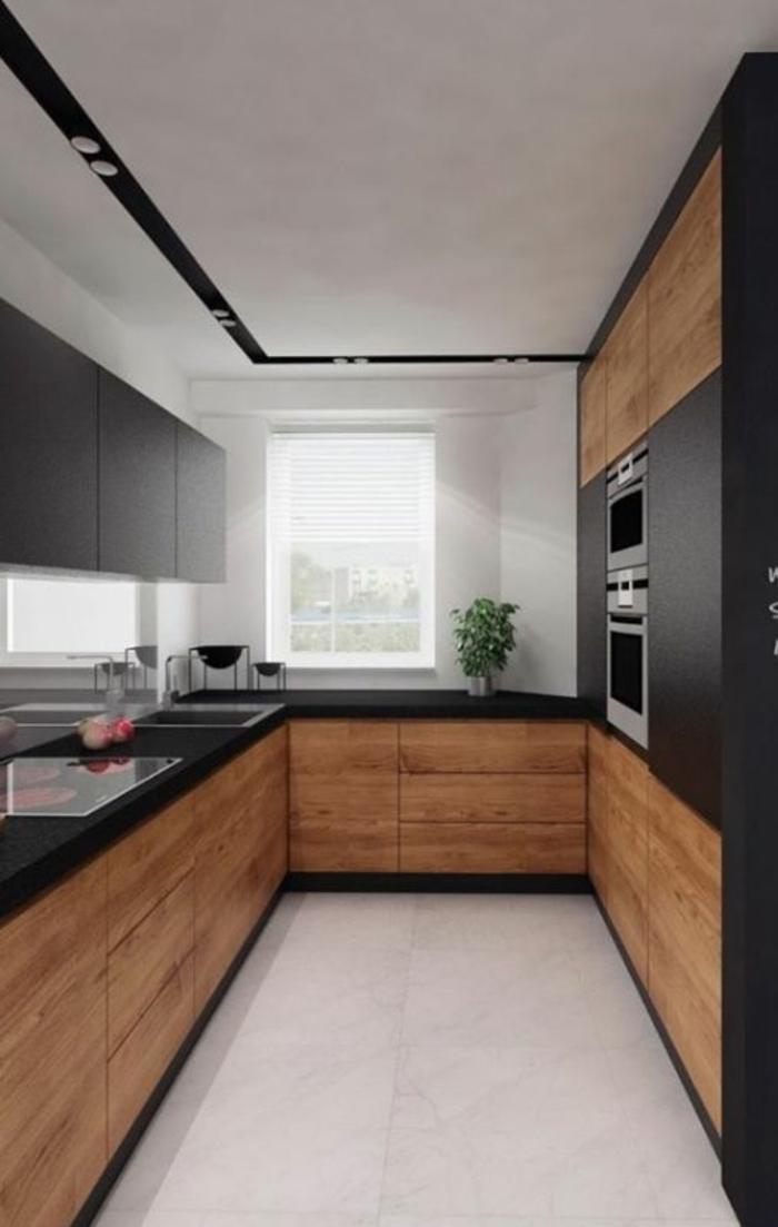 cuisine noir sol blanc au plafond blanc avec des bandes décoratives en noir avec des luminaires ronds incorporés