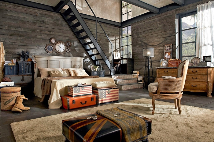 meuble industriel, escalier noir, murs en pierre, tête de lit en bois, horloge avec mécanisme, tapis moelleux, idee deco industrielle