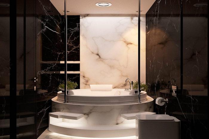 salle de bain design, déco blanc et noir, baignoire ovale en marbre, cuvette wc blanche