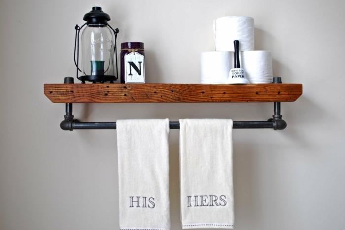 meuble industriel, meuble noir et bois, serviettes de bain, lanterne noire, murs blancs, accessoires de bain
