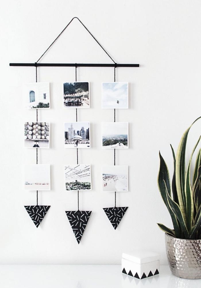 idée de présentoir photos suspendu, triangles en papier, idée rangement photos de vacances sur le fond d un mur blanc