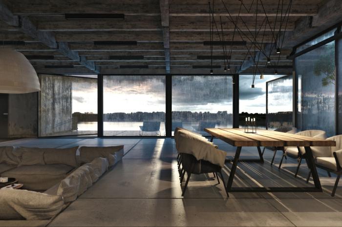 table basse industrielle, lampe suspendue à motif origami, deco industrielle, vue sur la nature, transats bleus, plafond avec poutres