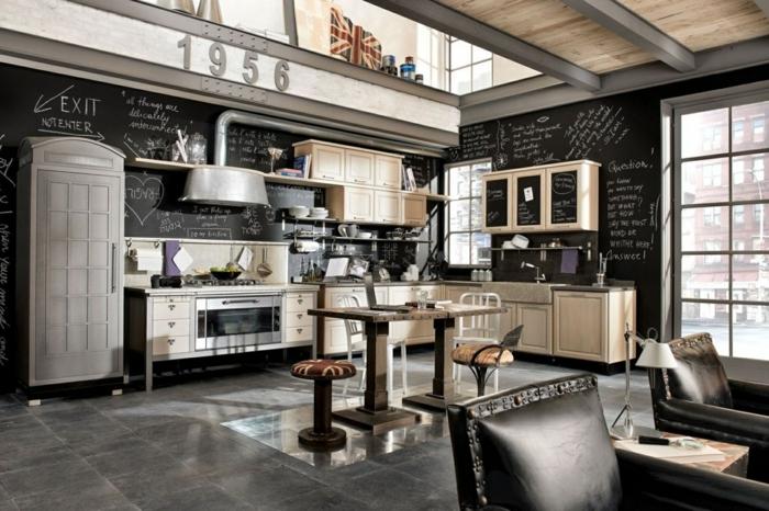 idee deco industrielle, carrelage gris, murs noirs, grande fenêtre, cuisine ouverte, fauteuil noir, commode beige