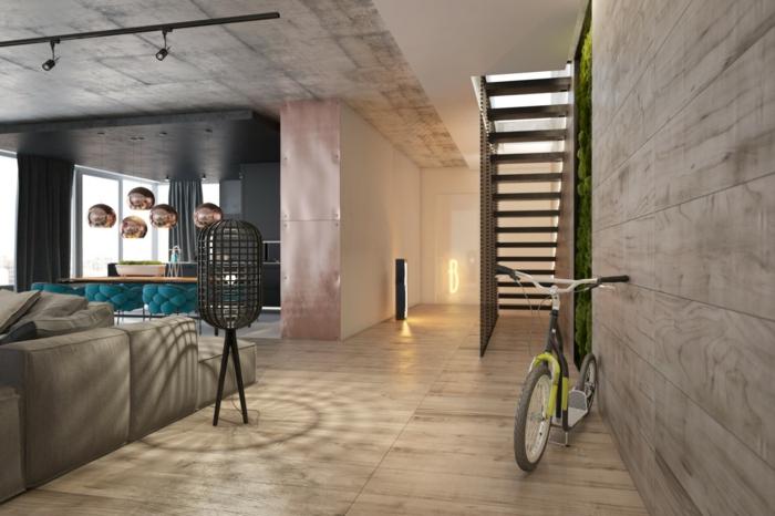 decoration industrielle, plancher en bois, canapé gris, fauteuil turquoise, plafond en béton, murs blancs