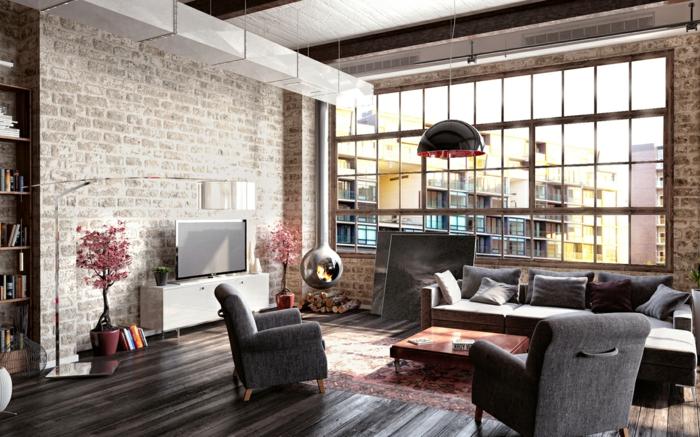 decoration industrielle, parquet noir, table basse en bois, tapis rouge, grande fenêtre, bibliothèque en bois