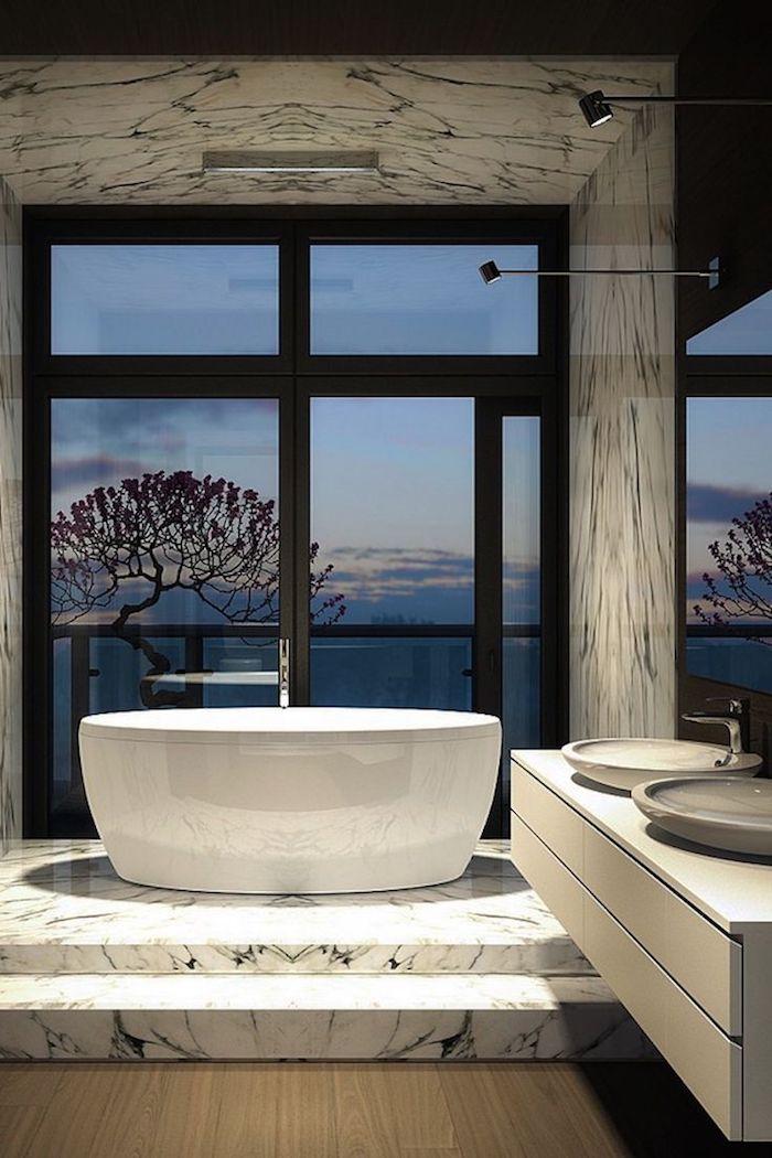 meubles salle de bain, lavabo céramique, robinet en acier, dallage effet marbre, vue sur la mer, arbres