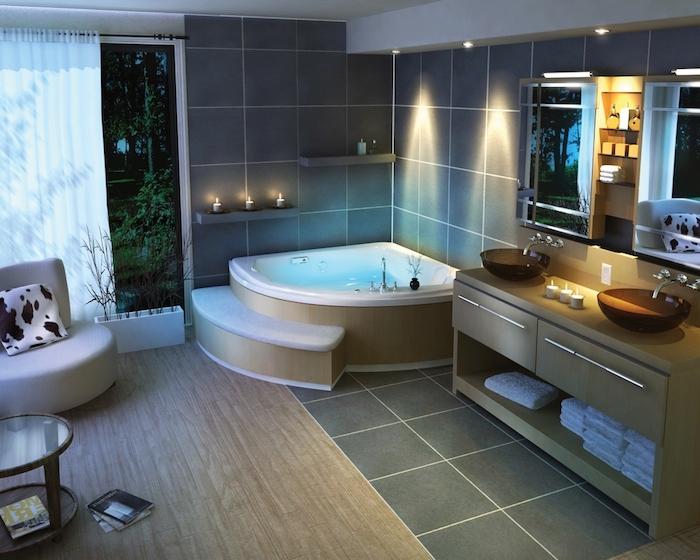 salle de bain moderne, dallage gris foncé, fauteuil blanc, coussin motifs animaux, serviette blanche