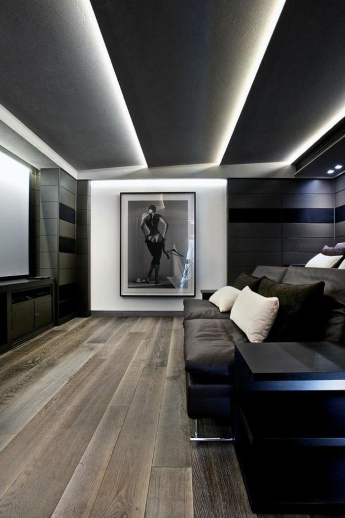 deco chambre adulte en noir et gris avec des coussins en blanc et noir