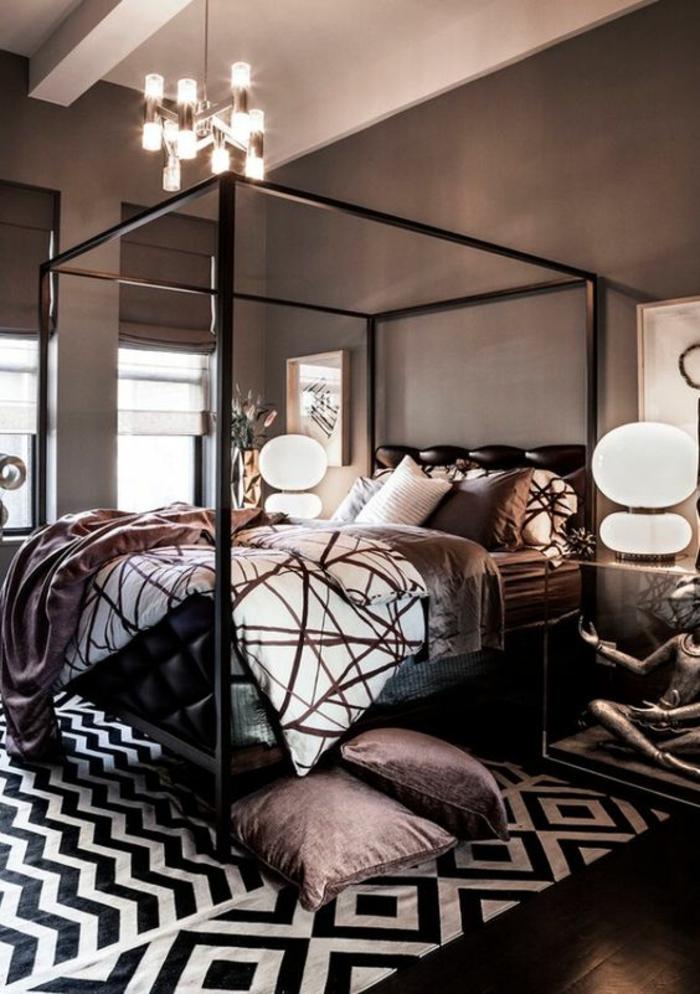 chambre design tapis noir et blanc motifs géométriques coussins et couverture couleur prune