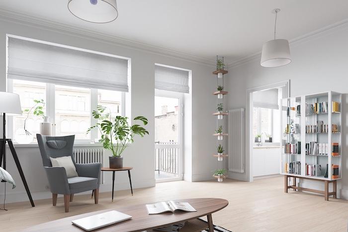 deco scandinave salon, fauteuil gris avec coussin blanc, petite table en bois ronde, étagère à fleurs