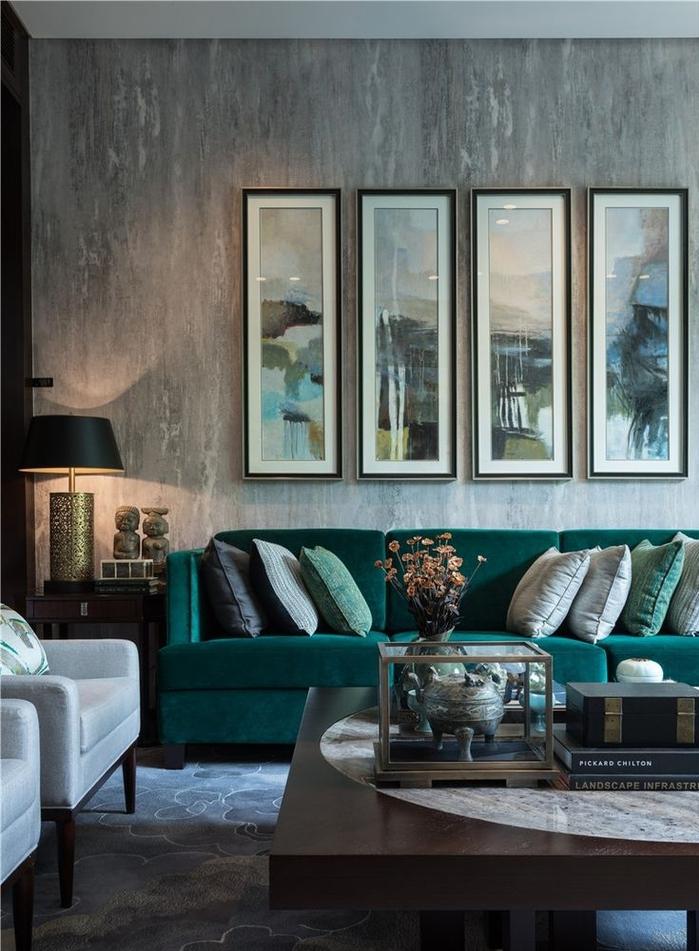 salon moderne aux nuances de gris et de vert canard, ambiance masculine qui oimbine les matières de luxe et les couleurs sombres