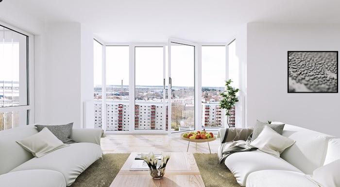 ambiance scandinave, parquet en bois, peinture blanc et noir avec cadre noir, canapé blanc en cuir, tapis moelleux en khaki