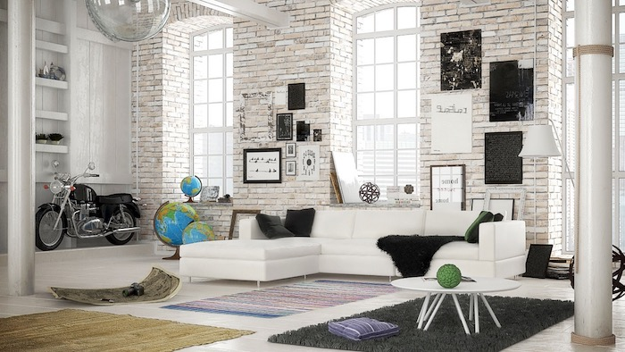 meuble scandinave, canapé d'angle en cuir blanc, petite table basse en blanc, tapis moelleux en gris foncé