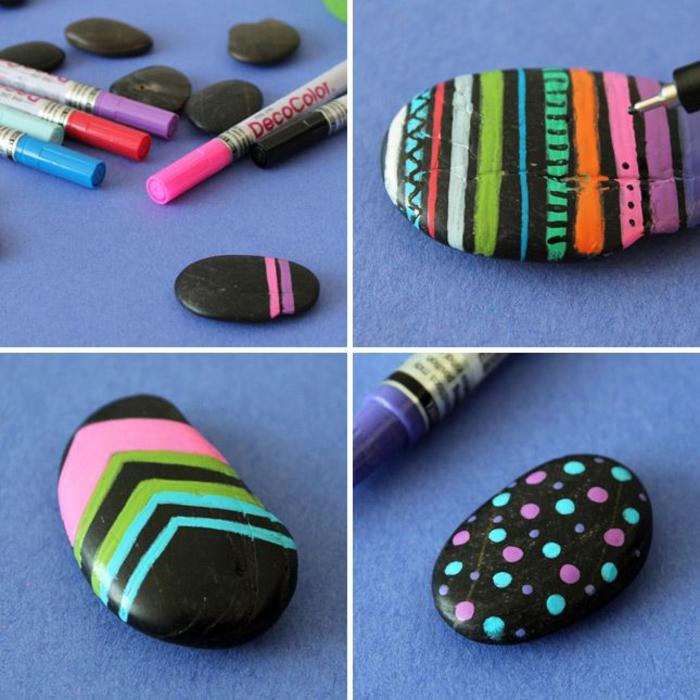 jolis motifs géométriques colorés réalisés sur des galets peints en noir