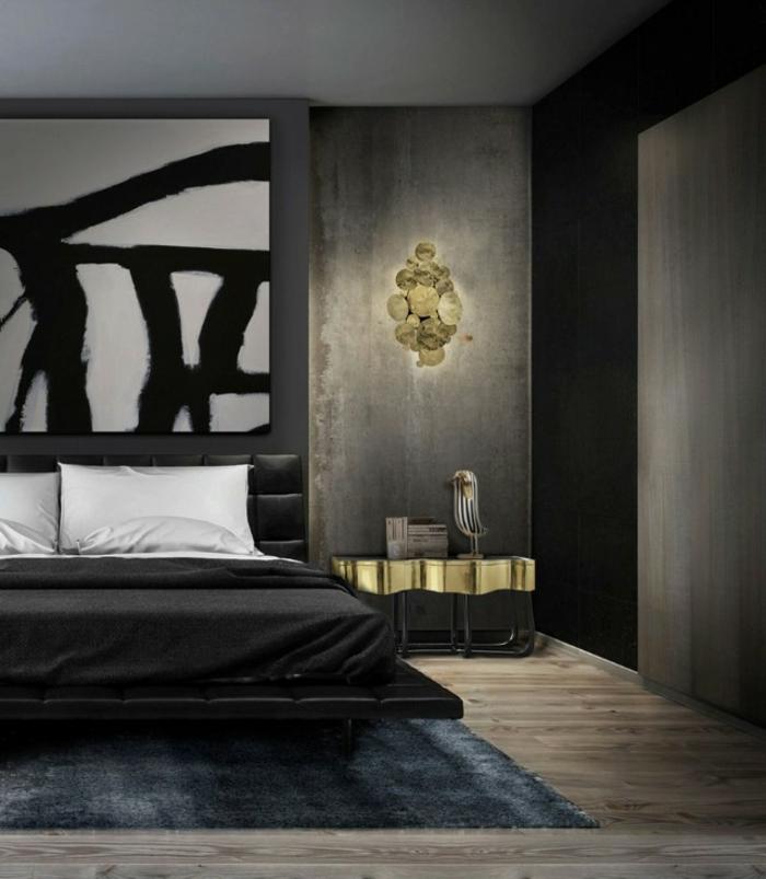 chambre design de luxe aux accents dorés avec des murs gris et panneau décoratif en noir et blanc
