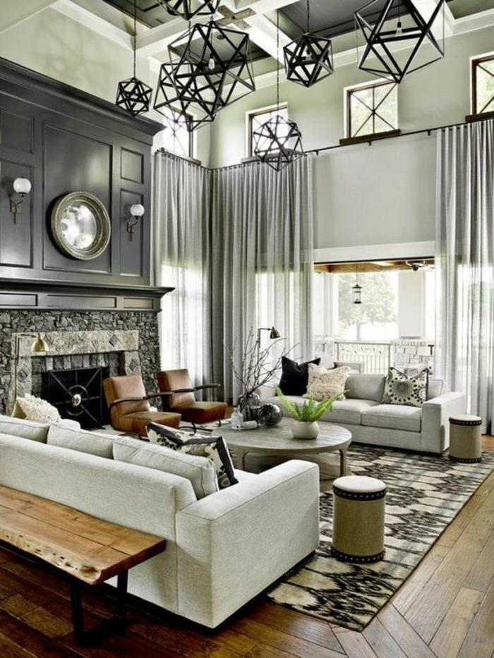 gris perle dans un salon au plafond haut avec des luminaires en formes géométriques a plusieurs angles