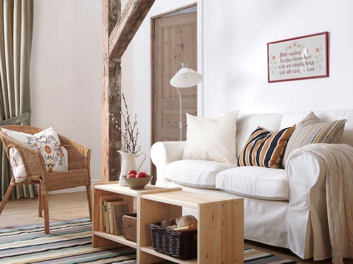 décoration scandinave, tapis en lignes droites multicolore, bol aux fruits, vase blanche avec fleurs séchées