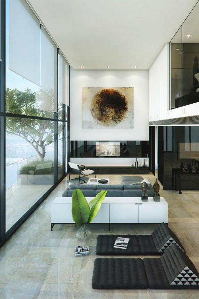 deco moderne salon, grand tableau artistique, petite enfilade blanche et canapé noir
