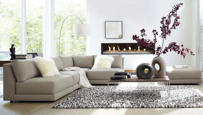 deco salon contemporain, canapé d'angle gris, table en bois et fer, tapi moelleux