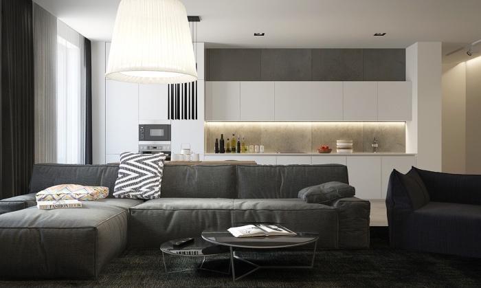 aménager une petite cuisine ouverte sur salon, façade cuisine blanche et crédence grise, ouverture sur salon avec canapé et tapis gris anthracite, table basse gigognes noires