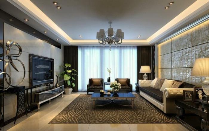 idée aménagement salon, plafonnier baroque, tapis à prints animaux, meuble de tv baroque