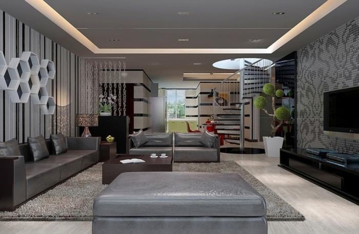 idées déco salon, écran monté au mur, escalier flottant, canapé en cuir gris
