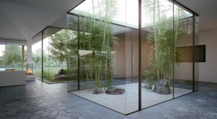 amenagement interieur, une sorte d aquarium, parois en verre, gravier, pierres et bambou à l interieur d une maison moderne, decoration zen