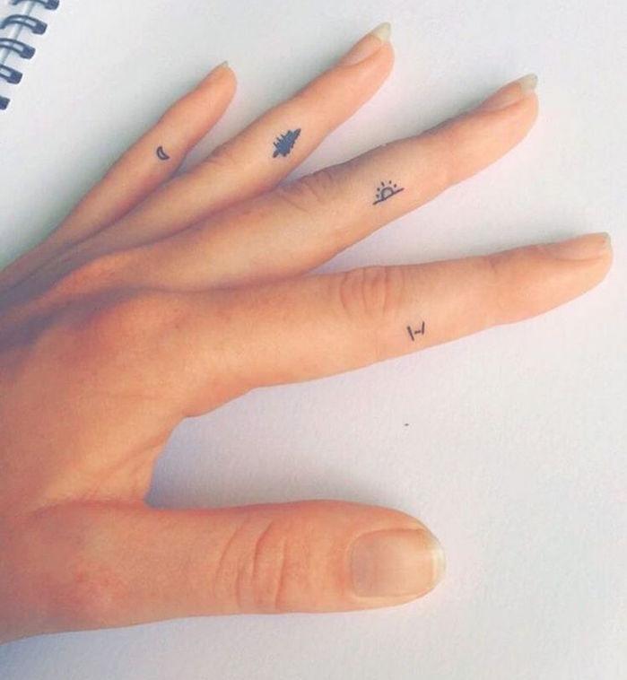 tatouage main femme tattoo doigts mini symboles nature