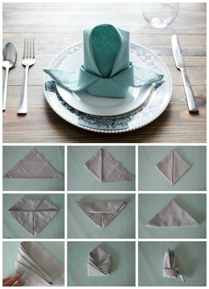 arrangement de table avec serviette plie élégante, assiette blanc avec contours à motifs floraux en bleu foncé