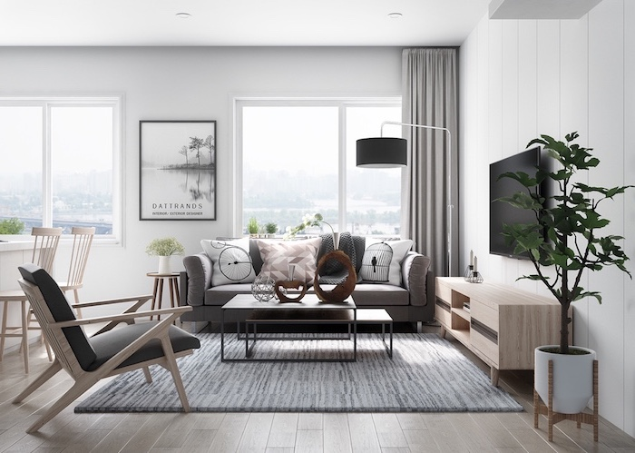 décoration scandinave, pot à fleur blanc, chaise en bois et cuir noir, art print en blanc et noir, rideaux longs en gris clair