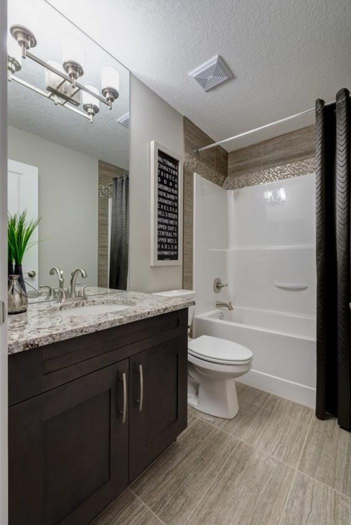 petites salle de bain aux meubles marron et carrelage lavabo imitation marbre