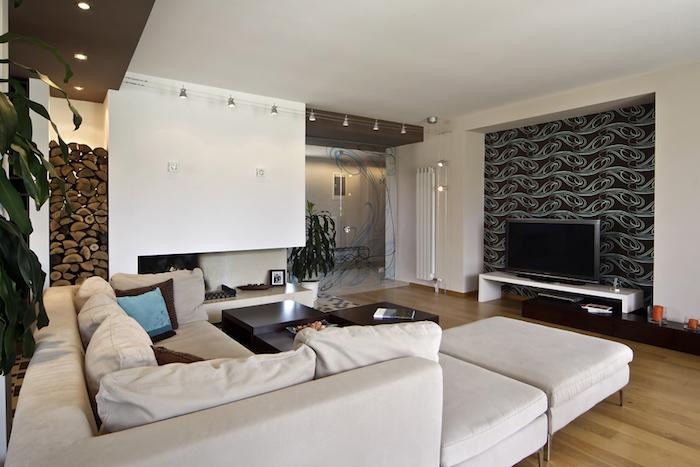 salon à la déco moderne et sobre avec stickers sur les murs