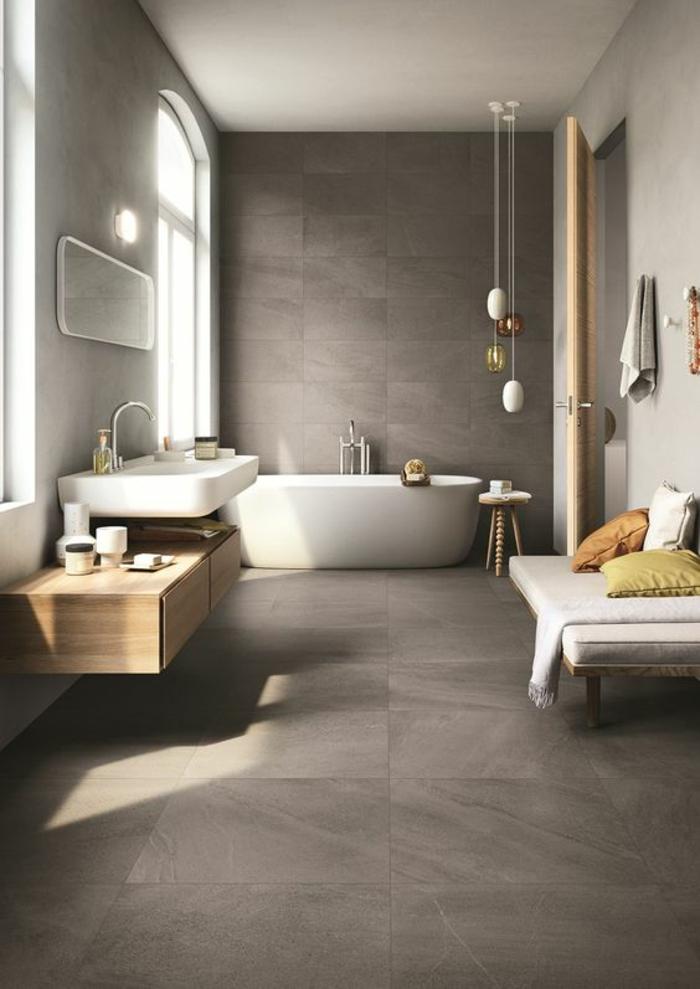 gris perle salle de bain avec trois luminaires suspendus et des grandes fenetres en arche
