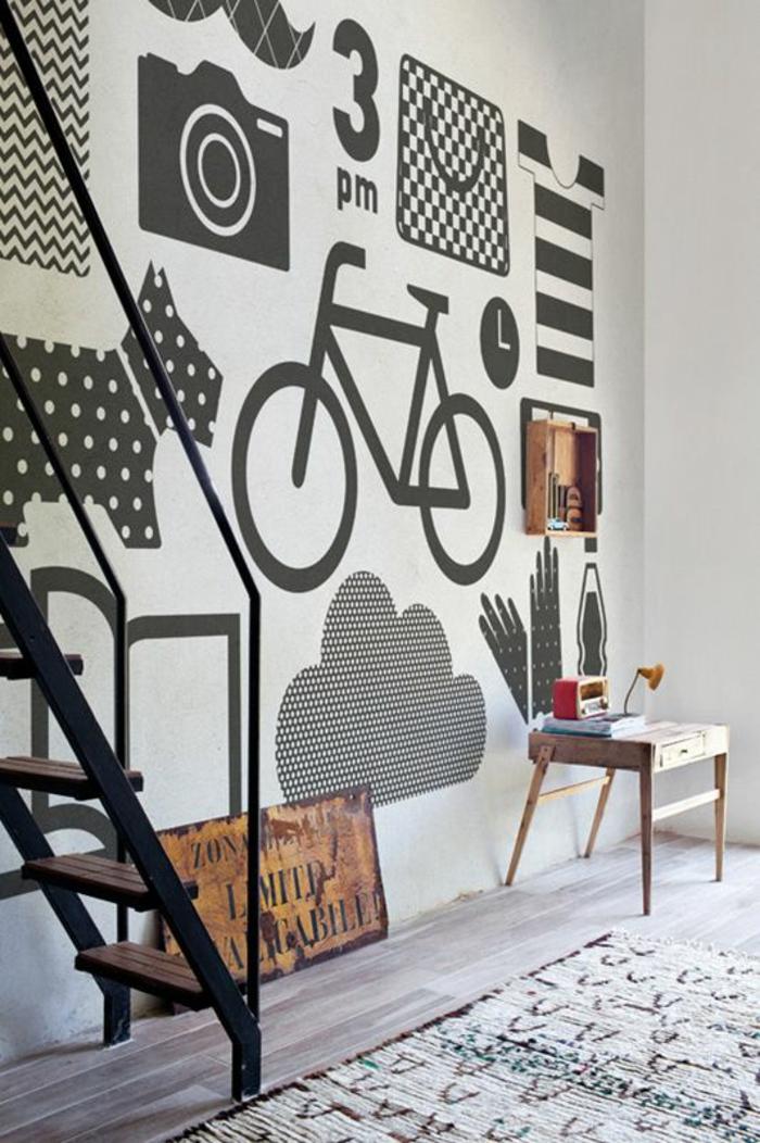 gris perle un salon au mur haut avec des motifs chien vélo appareil photo nuage moustache