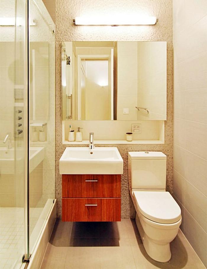 salle de bain très petite avec meuble suspendu en marron et blanc forme carrée