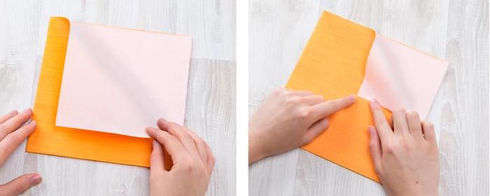 étapes à suivre pour maîtriser la technique origami, pliage de serviette orange en papier