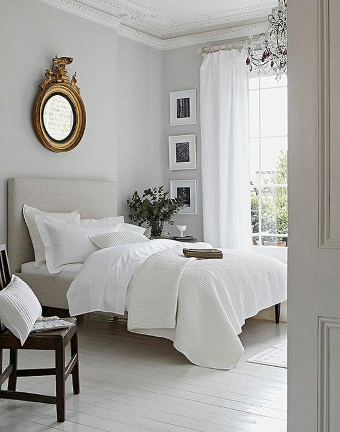 gris perle chambre a coucher lustre en cristal blanc miroir ovale au cadre doré style Empire