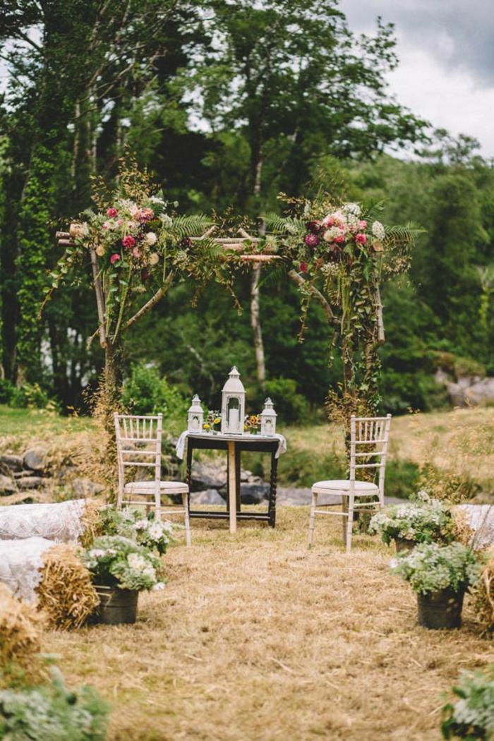 Noble déco mariage composition mariage chandelier fleuri pour mariage belle déco champetre table