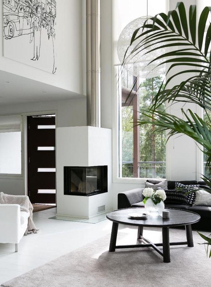 loft moderne avec salon blanc design et cheminée luxe