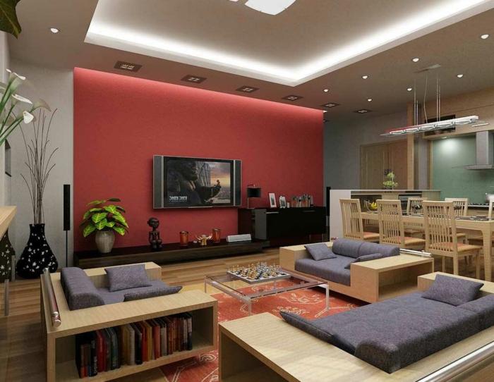 salon moderne, table basse acrylique, fauteuil avec rangement de livres, coussins gris
