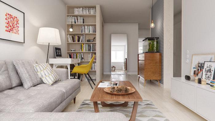 ambiance scandinave, bibliothèque à livres et objets décoratifs, chaise en jaune moutarde, table basse en bois