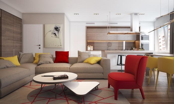 canapé couleur lin avec tapis gris à motifs géométriques rouges, couleur mur et plafond blanc, accents colorés jaunes et rouges