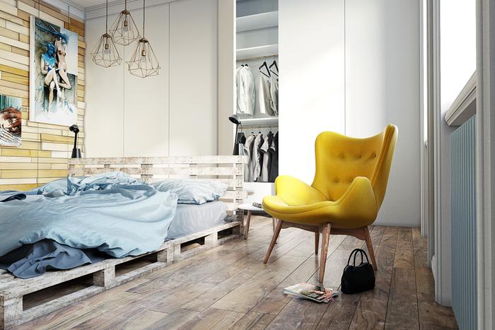 une chambre à coucher ensoleillée de style scandinave qui respire la tranquillité et la sérénité grâce au lit palette en bois, le mur en lambris et le parquet