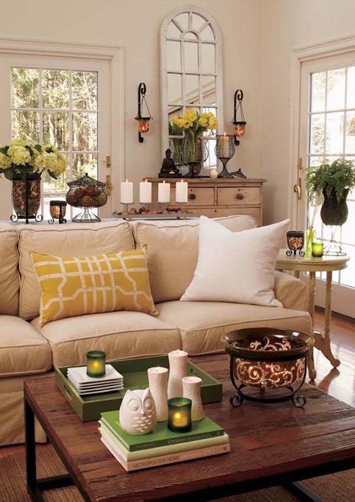 salle de séjour peinture murs beige taupe et canapé creme