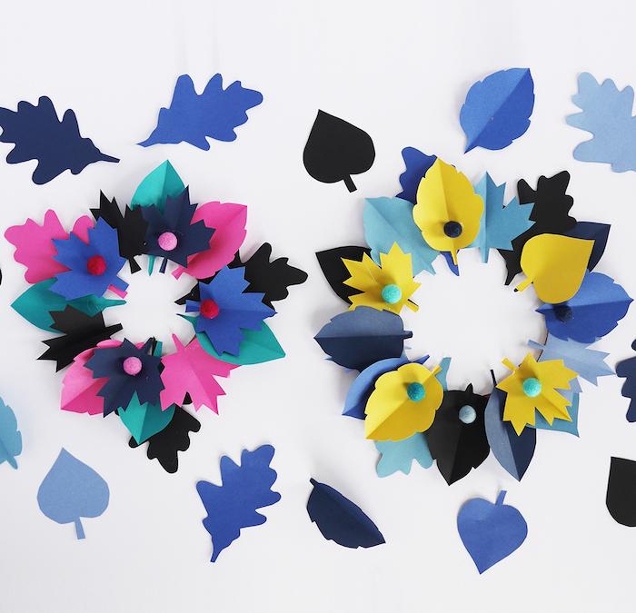 couronne de feuilles mortes en papier colorées assemblées, activité manuelle automne maternelle, petits pompons