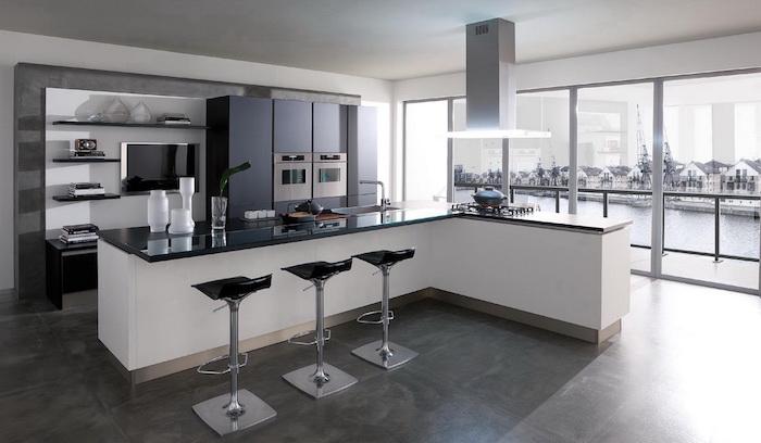 meuble cuisine, carrelage de sol en gris foncé, meubles de cuisine en noir sans poignées